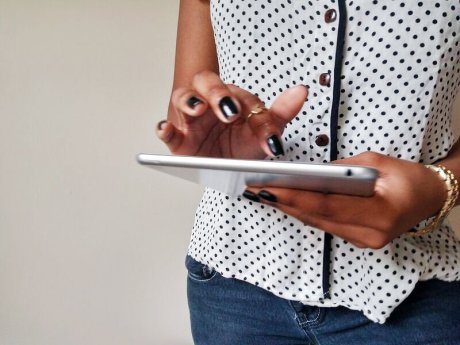 black-woman-holding-ipad-createherstock